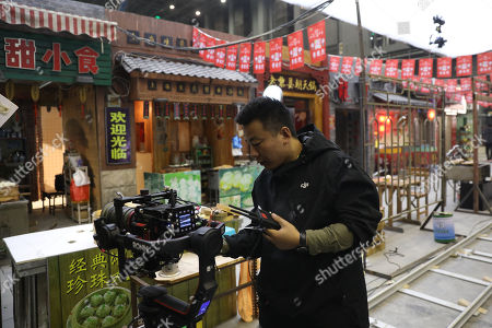 A member of a film crew works in a 10,000-square-meter film studio pavilion of Wanda Oriental Movie Metropolis in Qingdao, Shandong province, China, 28 April 2018. Wanda Qingdao Oriental Movie Metropolis opens on 28 April, a major Chinese studio, combining film and television production and several other facilities, funded by Wang Jianlin, CEO of the Dalian Wanda Group. The construction of the facility started on 22 September 2013, with the total investment of 50 billion RMB yuan (around 6.5 billion Euros), it has the world's largest studio pavilion of 10,000 square meters, featuring some of the world's largest and most technologically-advanced facilities.