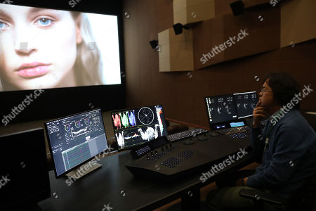 A producer performs color correction at a film post-production studio at Wanda Film Industrial Park of Wanda Oriental Movie Metropolis in Qingdao, Shandong province, China, 28 April 2018. Wanda Qingdao Oriental Movie Metropolis opens on 28 April, a major Chinese studio, combining film and television production and several other facilities, funded by Wang Jianlin, CEO of the Dalian Wanda Group. The construction of the facility started on 22 September 2013, with the total investment of 50 billion RMB yuan (around 6.5 billion Euros), it has the world's largest studio pavilion of 10,000 square meters, featuring some of the world's largest and most technologically-advanced facilities.