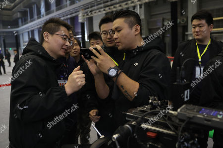 Film crew members check film clips as they work in a 10,000-square-meter film studio pavilion of Wanda Oriental Movie Metropolis in Qingdao, Shandong province, China, 28 April 2018. Wanda Qingdao Oriental Movie Metropolis opens on 28 April, a major Chinese studio, combining film and television production and several other facilities, funded by Wang Jianlin, CEO of the Dalian Wanda Group. The construction of the facility started on 22 September 2013, with the total investment of 50 billion RMB yuan (around 6.5 billion Euros), it has the world's largest studio pavilion of 10,000 square meters, featuring some of the world's largest and most technologically-advanced facilities.