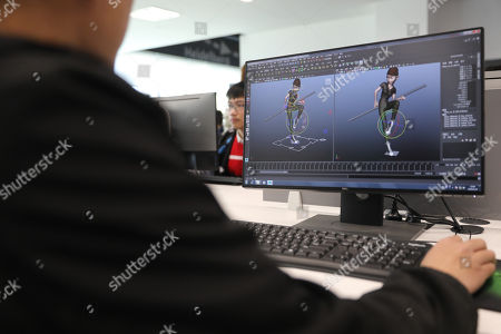 A film crew member works with Computer-generated imagery (CGI) on a computer at the Maker Space at Wanda Film Industrial Park of Wanda Oriental Movie Metropolis in Qingdao, Shandong province, China, 28 April 2018. Wanda Qingdao Oriental Movie Metropolis opens on 28 April, a major Chinese studio, combining film and television production and several other facilities, funded by Wang Jianlin, CEO of the Dalian Wanda Group. The construction of the facility started on 22 September 2013, with the total investment of 50 billion RMB yuan (around 6.5 billion Euros), it has the world's largest studio pavilion of 10,000 square meters, featuring some of the world's largest and most technologically-advanced facilities.