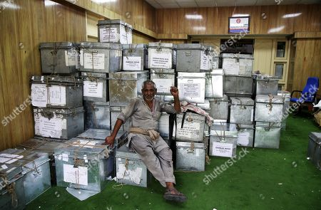 An Indian labourer takes rest near boxes containing official records of Jammu and Kashmir state's Civil Secretariat before they are loaded into trucks in Jammu, the winter capital of Kashmir, India, 28 April 2018. Jammu and Kashmir is the only state in India where 'Darbar' (government offices of all departments) are shifted bi-annually between the two state capitals. The offices remain functional for six winter months in Jammu which is the winter capital of the state and again are shifted back to Srinagar which is state's summer capital during summers. The trend of shifting state secretariat from one state capital to another has been going on in the state since 1872, the era of Maharaja Gulab Singh.