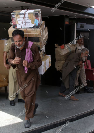 Indian labourers carry boxes, containing official records of Jammu and Kashmir state's Civil Secretariat, for loading into the trucks in Jammu, the winter capital of Kashmir, India, 28 April 2018. Jammu and Kashmir is the only state in India where 'Darbar' (government offices of all departments) are shifted bi-annually between the two state capitals. The offices remain functional for six winter months in Jammu which is the winter capital of the state and again are shifted back to Srinagar which is state's summer capital during summers. The trend of shifting state secretariat from one state capital to another has been going on in the state since 1872, the era of Maharaja Gulab Singh.