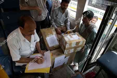 A Jammu and Kashmir government officer (L) keeps records of the boxes containing official records of Jammu and Kashmir state's Civil Secretariat as they are loaded into the trucks in Jammu, the winter capital of Kashmir, India, 28 April 2018. Jammu and Kashmir is the only state in India where 'Darbar' (government offices of all departments) are shifted bi-annually between the two state capitals. The offices remain functional for six winter months in Jammu which is the winter capital of the state and again are shifted back to Srinagar which is state's summer capital during summers. The trend of shifting state secretariat from one state capital to another has been going on in the state since 1872, the era of Maharaja Gulab Singh.