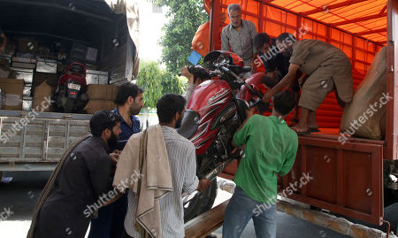Men load a motorcycle of a Jammu and Kashmir government employee into a truck in Jammu, the winter capital of Kashmir, India, 28 April 2018. Jammu and Kashmir is the only state in India where 'Darbar' (government offices of all departments) are shifted bi-annually between the two state capitals. The offices remain functional for six winter months in Jammu which is the winter capital of the state and again are shifted back to Srinagar which is state's summer capital during summers. The trend of shifting state secretariat from one state capital to another has been going on in the state since 1872, the era of Maharaja Gulab Singh.
