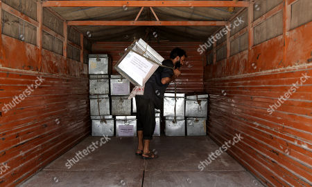 A man carries boxes containing official records of Jammu and Kashmir state's Civil Secretariat into the trucks in Jammu, the winter capital of Kashmir, India, 28 April 2018. Jammu and Kashmir is the only state in India where 'Darbar' (government offices of all departments) are shifted bi-annually between the two state capitals. The offices remain functional for six winter months in Jammu which is the winter capital of the state and again are shifted back to Srinagar which is state's summer capital during summers. The trend of shifting state secretariat from one state capital to another has been going on in the state since 1872, the era of Maharaja Gulab Singh.