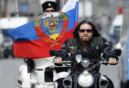 Alexander Zaldostanov (front), nicknamed 'Khirurg' (Surgeon), leader of the Russian motorcycle club the Night Wolves and his club-mates start their rally from Moscow to Berlin 'Victory Roads - to Berlin' from at the Manezhnaya square in central Moscow, Russia, 28 April 2018. The annual 'Victory Roads - to Berlin' motorcycle rally marking the 73st anniversary of victory over Nazi-Germany in WWII lasts for 14 days and covers 6,000 km.