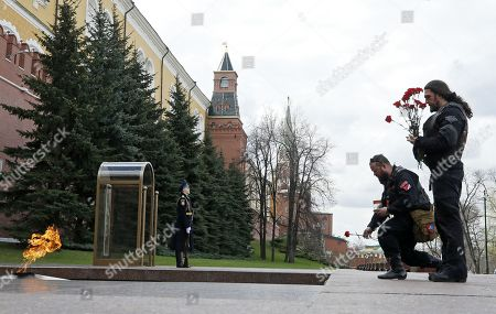 Alexander Zaldostanov (R), nicknamed 'Khirurg' (Surgeon), leader of the Russian motorcycle club the Night Wolves and his club-mates attend a wreath laying ceremony at the Tomb of the Unknown Soldier near the Kremlin wall prior the start their rally from Moscow to Berlin 'Victory Roads - to Berlin' from at the Manezhnaya square in central Moscow, Russia, 28 April 2018. The annual 'Victory Roads - to Berlin' motorcycle rally marking the 73rd anniversary of victory over Nazi-Germany in WWII lasts for 14 days and covers 6,000 km.