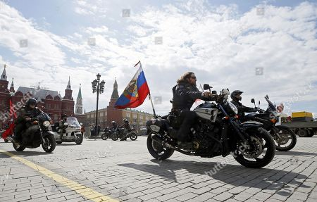 Alexander Zaldostanov (C), nicknamed 'Khirurg' (Surgeon), leader of the Russian motorcycle club the Night Wolves and his club-mates start their rally from Moscow to Berlin 'Victory Roads - to Berlin' from at the Manezhnaya square in central Moscow, Russia, 28 April 2018. The annual 'Victory Roads - to Berlin' motorcycle rally marking the 73st anniversary of victory over Nazi-Germany in WWII lasts for 14 days and covers 6,000 km.