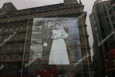 """Stock Photo of Pictures of Winnie Mandela are projected on to the window of South Africa house follwing the death of Winnie Mandela regarded as """"Mother of the Nation"""" who fought against the Apartheid regime"""