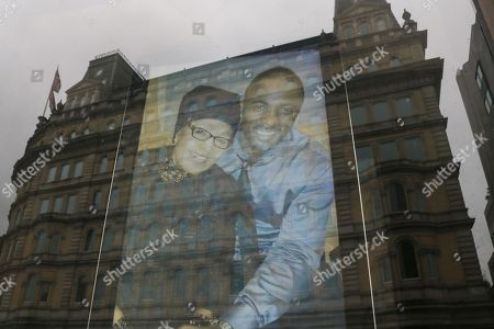 """Pictures of Winnie Mandela are projected on to the window of South Africa house follwing the death of Winnie Mandela regarded as """"Mother of the Nation"""" who fought against the Apartheid regime"""