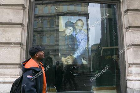 """Stock Image of Pictures of Winnie Mandela are projected on to the window of South Africa house follwing the death of Winnie Mandela regarded as """"Mother of the Nation"""" who fought against the Apartheid regime"""