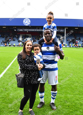 Nedum Onuoha of QPR poses for a photo with his family after the final home match of his QPR career
