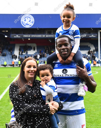 Nedum Onuoha of QPR poses for a family photo after the last home match of his QPR career