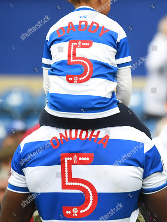 Nedum Onuoha of QPR with one of his children on his braod shoulders
