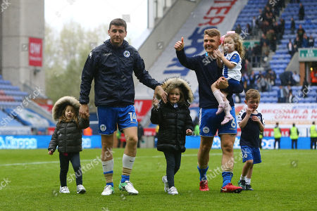 Wigan?s Alex Bruce and Max Power with their children, applaud the fans