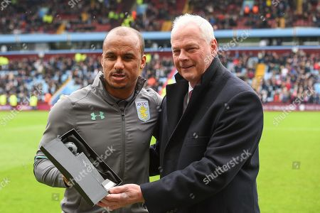 Aston Villa's Gabriel Agbonlahor is presented with an award by Villa's U23 team manager, Kevin MacDonald in recognition of his final game for Aston Villa after 12 years and nearly 400 appearances since joining Aston Villa in 2006 during the EFL Sky Bet Championship match between Aston Villa and Derby County at Villa Park, Birmingham. Picture by Jon Hobley