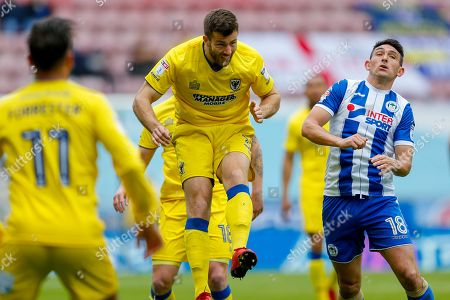 AFC Wimbledon defender Jonathan Meades (3) heads away during the EFL Sky Bet League 1 match between Wigan Athletic and AFC Wimbledon at the DW Stadium, Wigan. Picture by Simon Davies