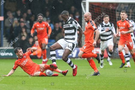Forest Green Rovers Isaiah Osbourne(34) is tackled by Luton Town's Dan Potts during the EFL Sky Bet League 2 match between Luton Town and Forest Green Rovers at Kenilworth Road, Luton. Picture by Shane Healey