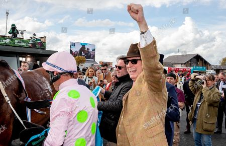 Owner Rich Ricci celebrates as Robbie Power wins The AES Champion Four Year Old Hurdle with Saldier