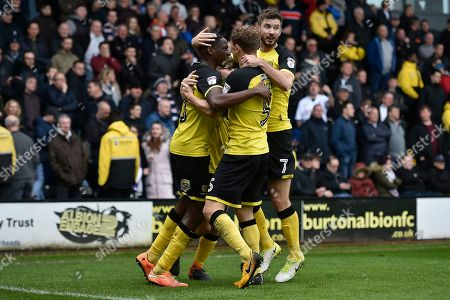Stock Photo of Burton Albion striker Lucas Akins (10) celebrates scoring a goal, making the score 2-0, with team-mates during the EFL Sky Bet Championship match between Burton Albion and Bolton Wanderers at the Pirelli Stadium, Burton upon Trent. Picture by Richard Holmes