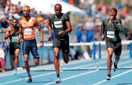 Jeffery Gibson, Javier Culson, T.J. Holmes. Jeffery Gibson, center, races to the finish line ahead of Javier Culson, left, and T.J. Holmes, right, while winning the men's elite 400-meter hurdles at the Drake Relays athletics meet, in Des Moines, Iowa