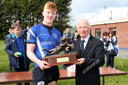 Skerries RFC vs Bandon RFC. Bandon's Josh Brady is presented with the National Under 18 Trophy by Michael Cunningham of the IRFU