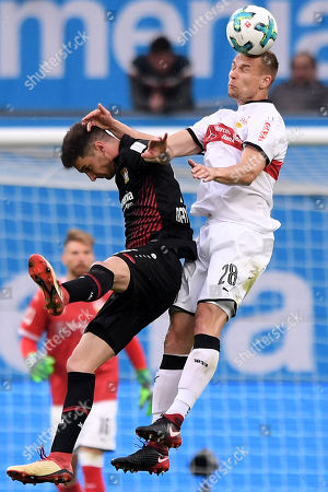 Leverkusen's Lucas Alario (L) in action against Stuttgart's Holger Badstuber (R) during the German Bundesliga soccer match between Bayer Leverkusen and VfB Stuttgart at BayArena in Leverkusen, Germany, 28 April 2018.
