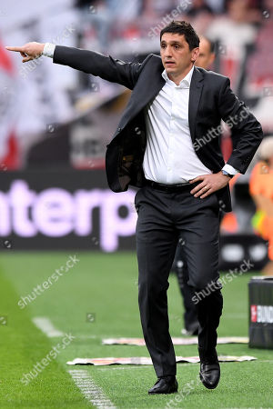 Stuttgart's head coach Tayfun Korkut gestures during the German Bundesliga soccer match between Bayer Leverkusen and VfB Stuttgart at BayArena in Leverkusen, Germany, 28 April 2018.
