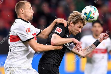 Stuttgart's Holger Badstuber (L) in action against Leverkusen's Stefan Kiessling (R) during the German Bundesliga soccer match between Bayer Leverkusen and VfB Stuttgart at BayArena in Leverkusen, Germany, 28 April 2018.