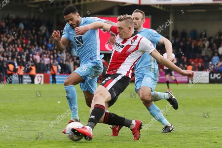 Jordan Willis, Danny Wright and Liam Kelly during the EFL Sky Bet League 2 match between Cheltenham Town and Coventry City at LCI Rail Stadium, Cheltenham. Picture by Antony Thompson