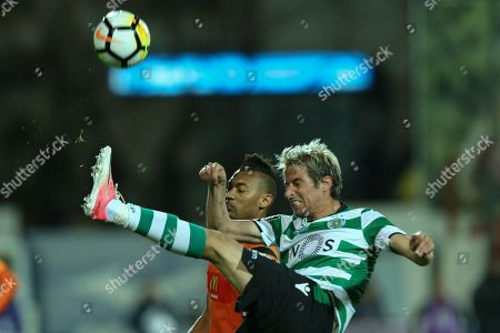 Portimonense´s player Ewerton (L) in action against Sporting´s player Fabio Coentrao (R) during their Portuguese First League soccer match held at Portimao Stadium, in Portimao, South of Portugal, 28 April 2018.