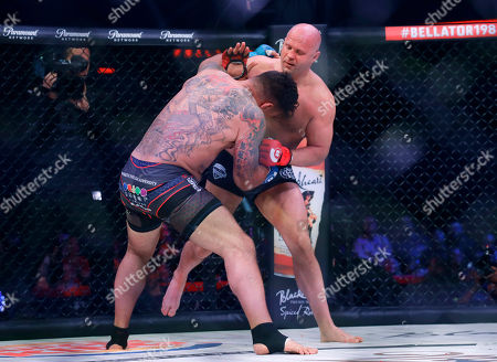 Stock Image of Fedor Emelianenko, Frank Mir. Fedor Emelianenko, right, of Russia, fights Frank Mir in a heavyweight mixed martial arts bout at Bellator 198, in Rosemont, Ill. Emelianenko defeated Mir