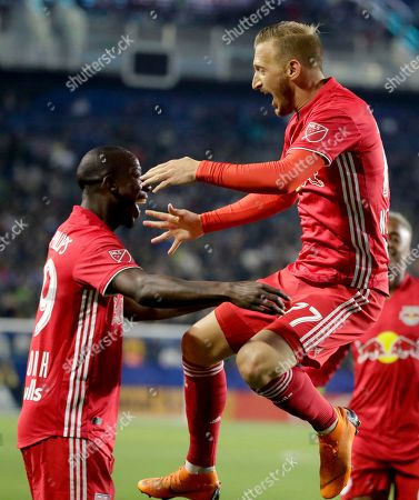 New York Red Bulls midfielder Daniel Royer, right, celebrates his goal with forward Bradley Wright-Phillips during the first half of an MLS soccer match against the Los Angeles Galaxy, in Carson, Calif