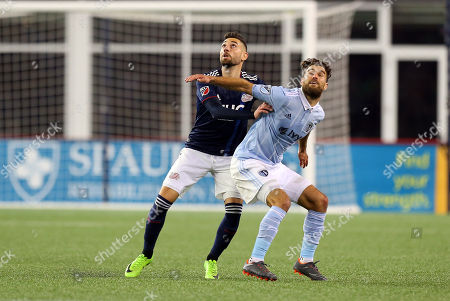 , 2018; Foxborough, MA, USA; New England Revolution defender Gabriel Somi (91) and Sporting Kansas City midfielder Graham Zusi (8) in action during an MLS match between Sporting KC and New England Revolution at Gillette Stadium. New England won 1-0