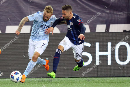 , 2018; Foxborough, MA, USA; Sporting Kansas City forward Johnny Russell (7) and New England Revolution defender Gabriel Somi (91) in action during an MLS match between Sporting KC and New England Revolution at Gillette Stadium. New England won 1-0