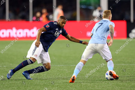 , 2018; Foxborough, MA, USA; New England Revolution defender Andrew Farrell (2) defends Sporting Kansas City forward Johnny Russell (7) during an MLS match between Sporting KC and New England Revolution at Gillette Stadium. New England won 1-0