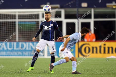 Stock Image of , 2018; Foxborough, MA, USA; New England Revolution defender Gabriel Somi (91) heads the ball in action during an MLS match between Sporting KC and New England Revolution at Gillette Stadium. New England won 1-0