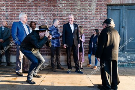 Phil Murphy, Danny Clinch, Danny Devito. Danny Clinch, left, photographs Danny Devito, right and New Jersey Governor Phil Murphy, center looks on at the Asbury Park Music and Film Festival at The Paramount Theatre on in Asbury Park, NJ