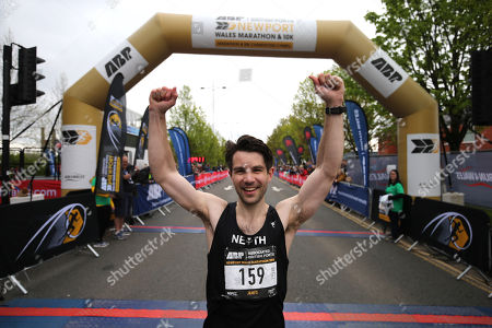 James Carpenter celebrates winning the Newport Wales Marathon.