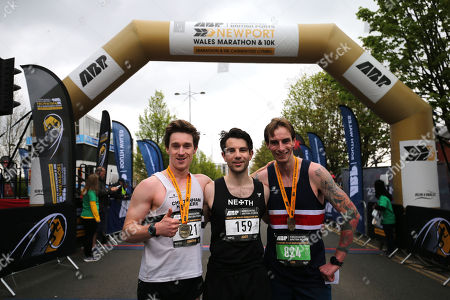 James Carpenter (middle) celebrates winning the Newport Wales Marathon with runners up Jonathan Barnes (L) and Luke Williams (R).
