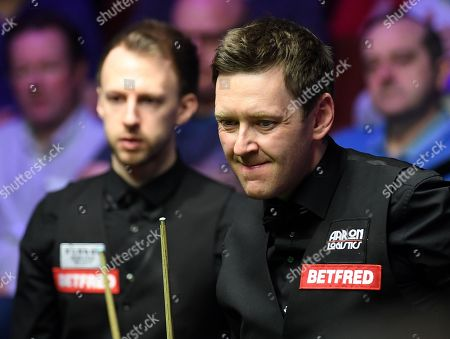 Judd Trump of England (left) and Ricky Walden of England  during their second round match