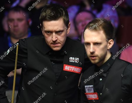 Ricky Walden of England (left) and Judd Trump of England during their second round match