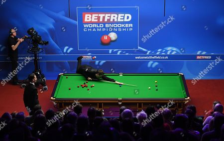 Ricky Walden of England at the table during his second round match
