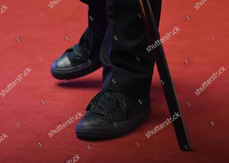 Ricky Walden of England wears trainers during his second round match