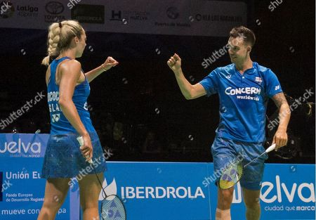 England's Chris Adcock and Gabrielle Adcock (L) react during the mixed doubles final match against Denmark's Mathias Christianssen and Christina Pedersen at the European Badminton Championships in Huelva, southern Spain, 29 April 2018.