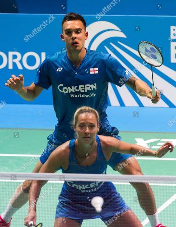 England's Chris Adcock and Gabrielle Adcock (down) in action during the mixed doubles final match against Denmark's Mathias Christianssen and Christina Pedersen at the European Badminton Championships in Huelva, southern Spain, 29 April 2018.