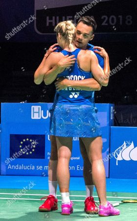 England's Chris Adcock (facing) and Gabrielle Adcock celebrate after winning the mixed doubles final match against Denmark's Mathias Christianssen and Christina Pedersen at the European Badminton Championships in Huelva, southern Spain, 29 April 2018.
