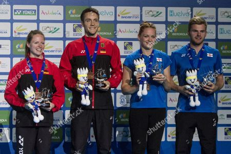 Britain Chris Adcock (R) and Gabrielle Adcock (2R) celebrate the gold after the European Badminton Championships mixed doubles final match in Huelva, southern Spain, 29 April 2018.