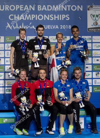 (up) Britain Chris Adcock (R) and Gabrielle Adcock (2R) celebrate the gold on the podium after the European Badminton Championships mixed doubles final match in Huelva, southern Spain, 29 April 2018.