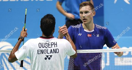 Viktor Axelsen (R) of Denmark celebrates winning the men's singles final match against England's Rajiv Ouseph (L) at the European Badminton Championships in Huelva, southern Spain, 29 April 2018.